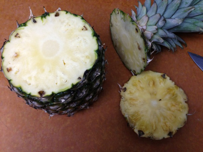 cut pineapple top and bottom