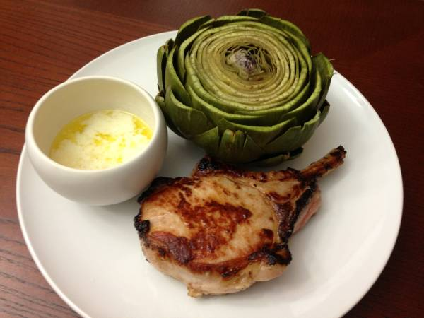 honey jack peppercorn pork chop and steamed artichoke